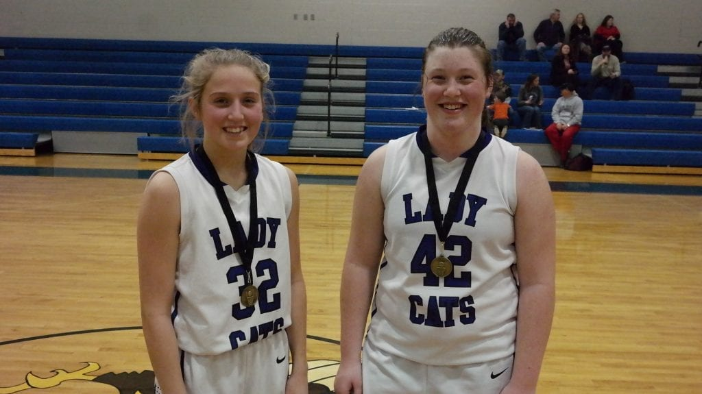 After the game, the NGML awarded eighth-grade CCMS Lady Cat Bailey Teague (32) with the All-Tournament Medal and Jalynn Ledford (42) with the Academic Medal. (Photo by: Kevin Hensley)