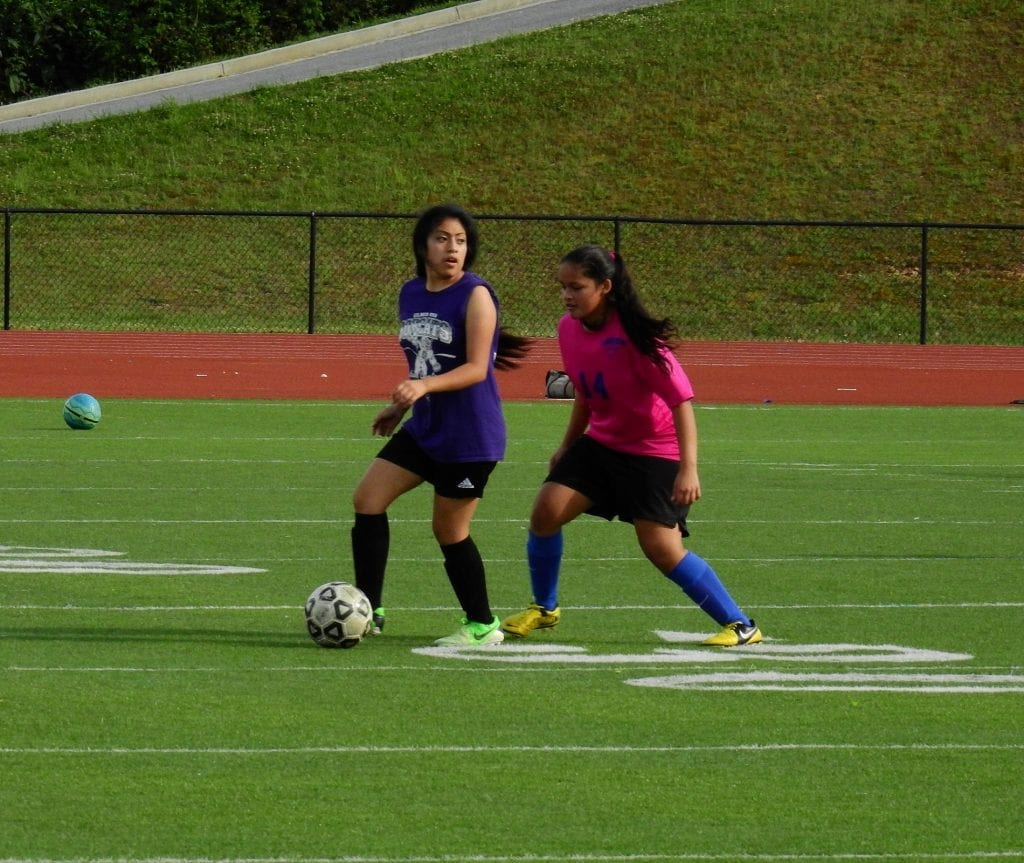 Lady Cat Elsa Francisco looks upfield for an open player, during a friendly match against Fannin Monday. Francisco scored a match-tying goal late in the second half, but the Lady Rebels responded less than a minute later to take an eventual match-winning 3-2 victory. (Photo by: Kevin Hensley)