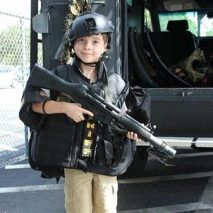 A donated picture from Tyler's Family of him trying on police gear.