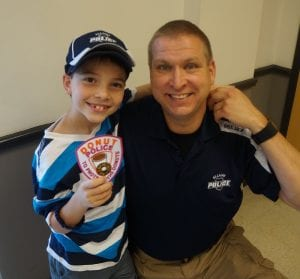 "Tyler receives a patch for the ""Donut Police"" after visiting Ellijay."