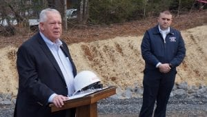 Public Safety Director Tony Pritchett looks on as Georgia Speaker of the House David Ralston offers a few words for the fire station groundbreaking.