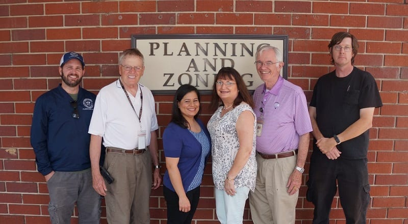 Picture above, from left to right, the Planning and Zoning staff includes Matt Green, James Holloway, Yvette Feliberty, Karen Henson, Loy Jarrett, and Andrew Mathis. Not pictured is Suzanne Mullinax.