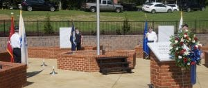 The Honor Guard presents the military branch flags beginning the ceremony of dedication for Veterans Memorial Park.