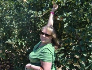 Paige Green stops to pick her first ever Gilmer Apple in 2008 when she joins the Gilmer Chamber.
