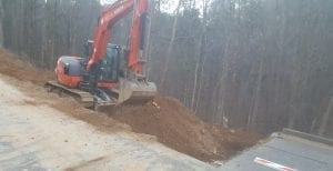 While digging out under a section of road on Bobcat Trail, DSR Contracting struck the gas line.